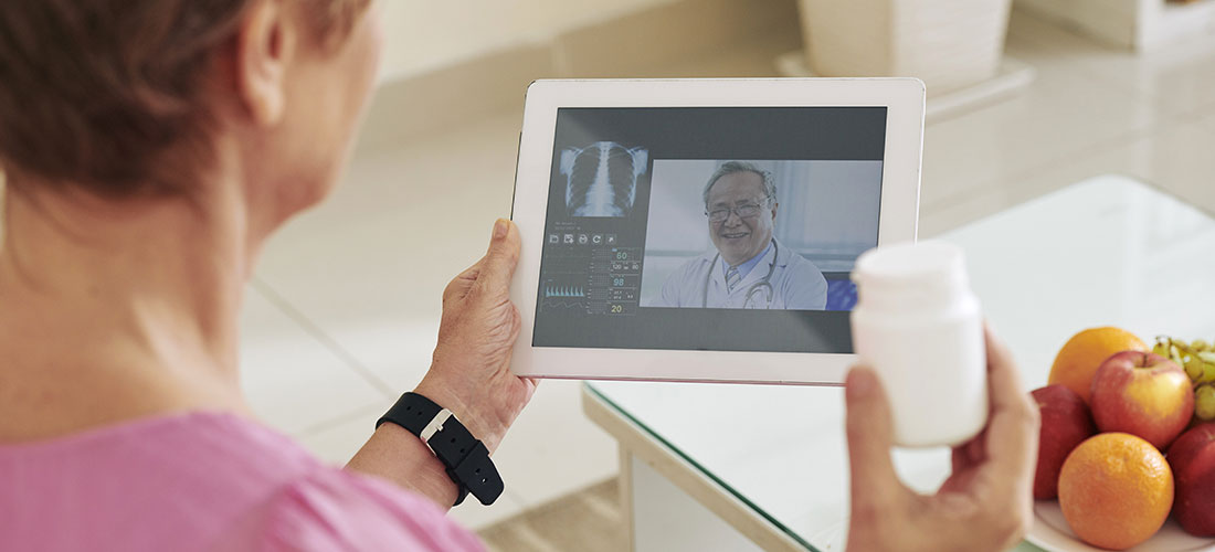 Photo of doctor and patient talking on a telemedicine video appointment