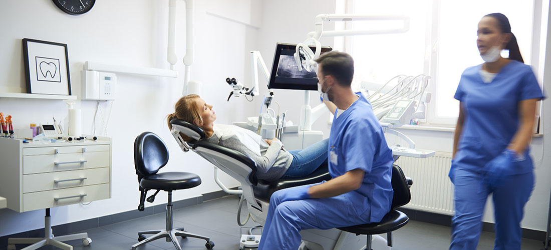 photo of dentists working with patient in dental clinic