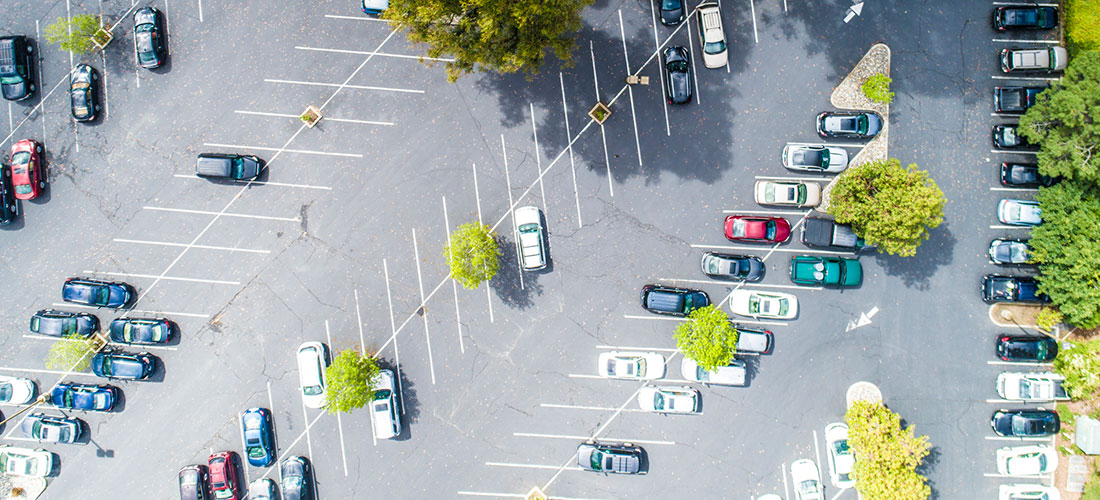 Photo of cars parked in employer parking lot