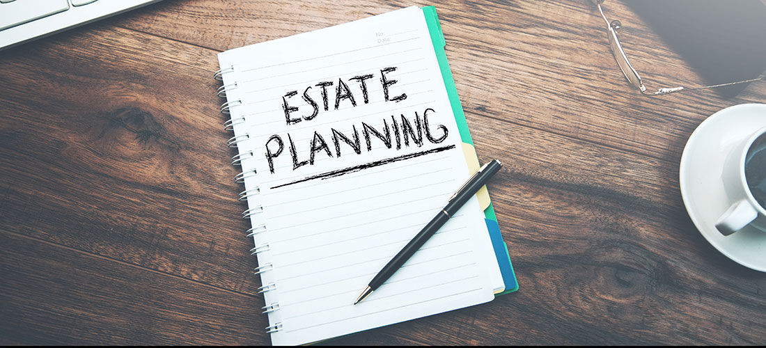 """Image of a notebook with the words """"estate planning"""" written on it"""