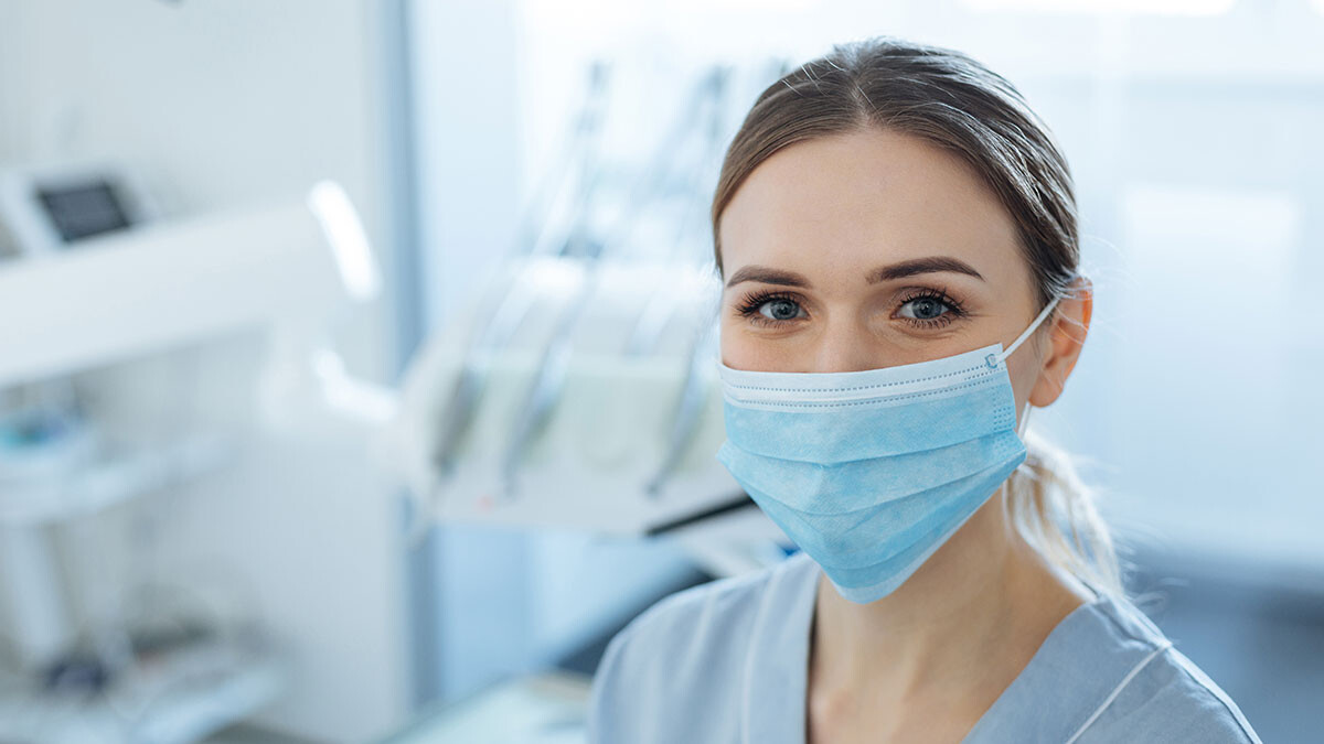 image of a dentist with mask on