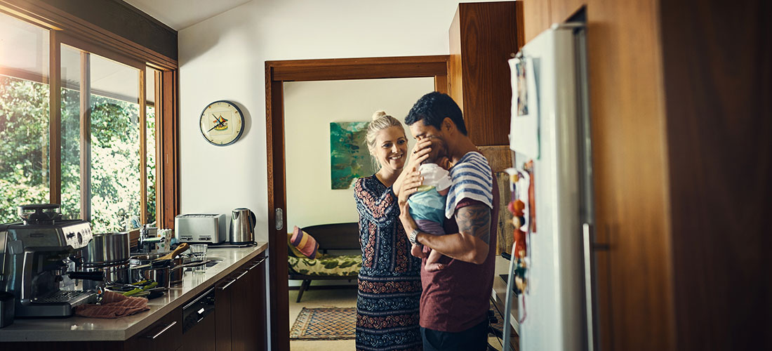 photo of new parents at home on Family and Medical Leave taking care of their newborn baby