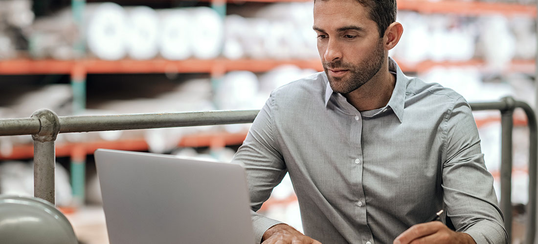 Business owner working on laptop calculating ppp loan forgiveness numbers