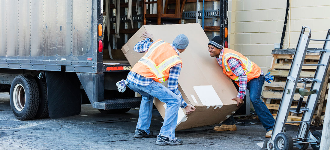 Photo of nonprofit volunteers unloading non cash donations from truck